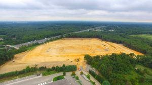 Aerial perspective of the site excavation.