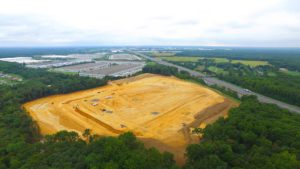 Aerial view of site clearing and of Interstate - Phase 2 project.