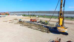 Excavator driving piles for Port E project in Elizabeth, New Jersey.