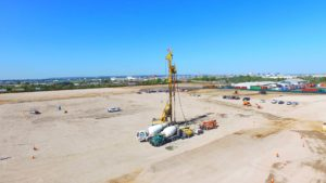 Excavator, cement mixers and heavy equipment working on preparing site development for Port E in Elizabeth, New Jersey.