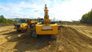 A Petillo excavator clearing and levelling top soil.